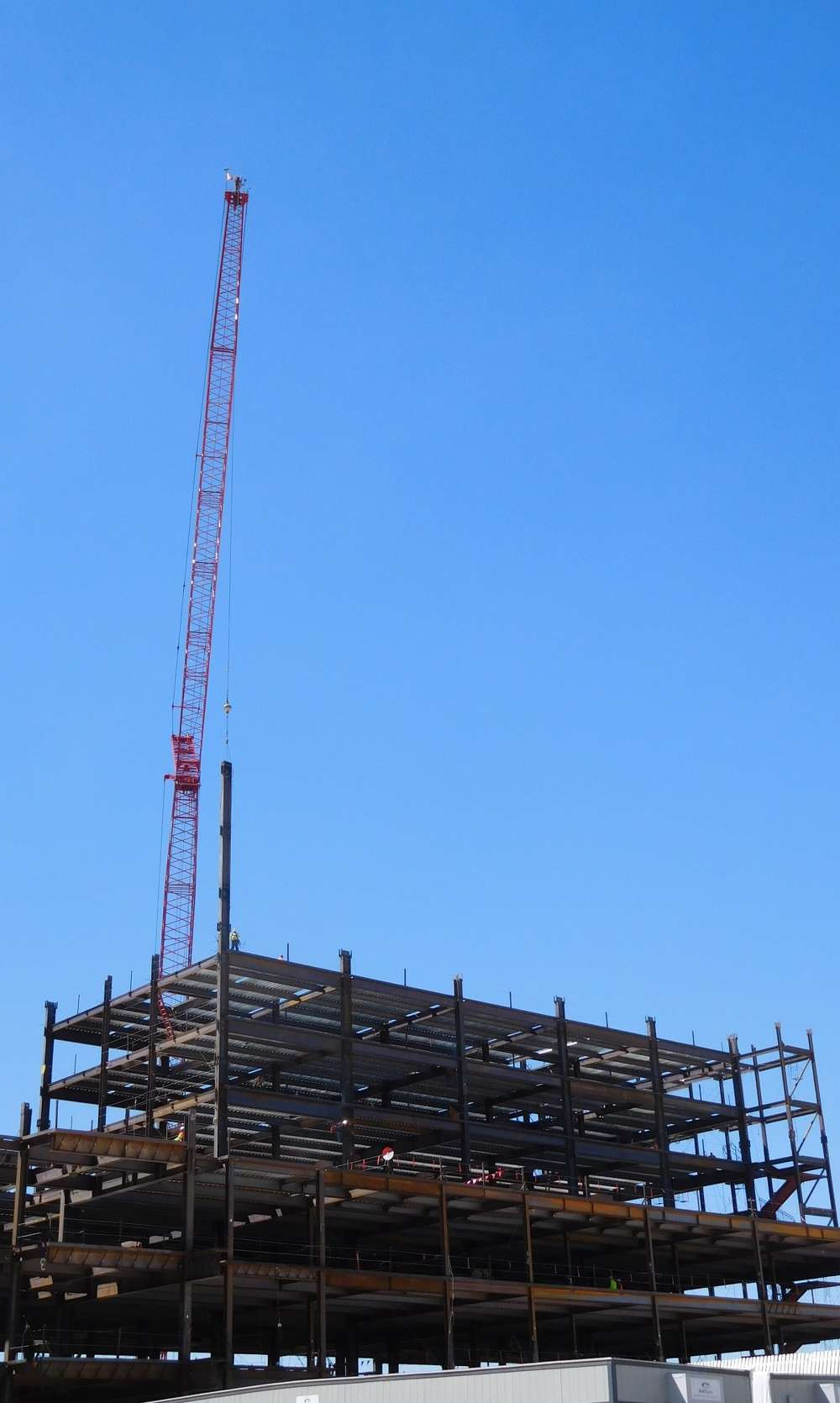 Sundt Construction Inc. photo. A crane was in place during initial construction during summer and a second larger crane is now used to handle a portion of the steel erection.
