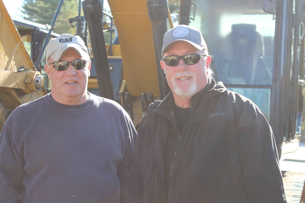 Steve Tedstone (L), salesman, and Mike Sherman, used equipment manager, both of Milton CAT, were in attendance at the North Country sale.