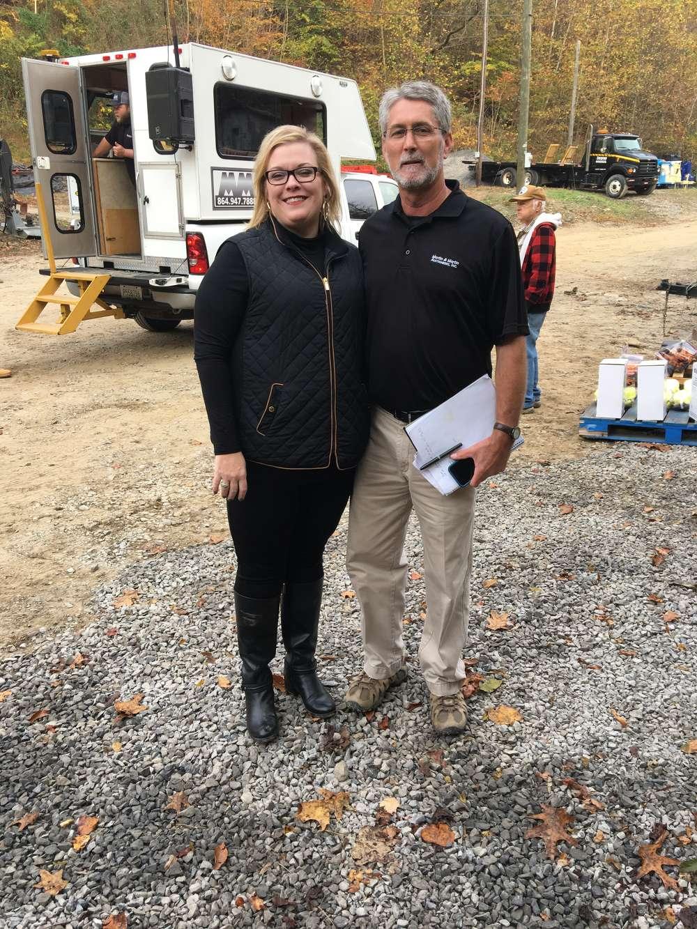 Jennifer Martin and Rob Newsome, West Virginia territory representative of Martin & Martin Auctioneers Inc., prepare for the sale.