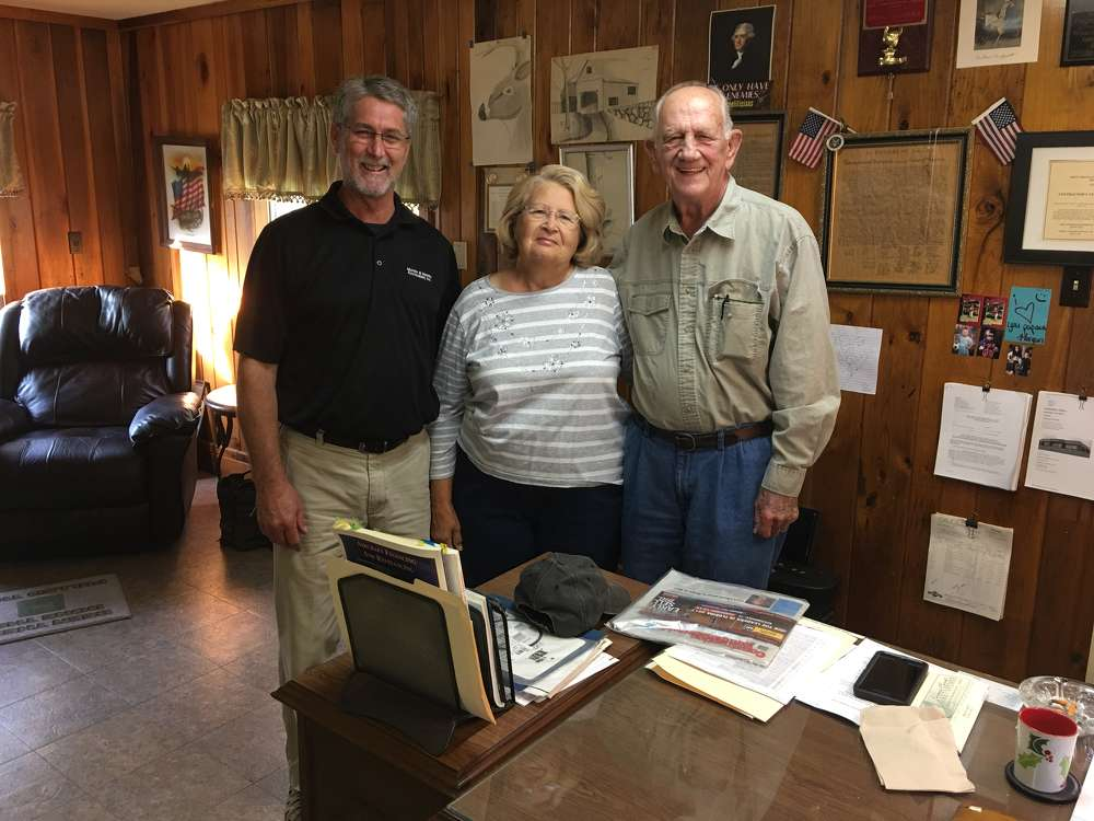 (L-R) are Rob Newsome, West Virginia territory representative of Martin & Martin Auctioneers Inc., and Jody and David Cochran, the owners of Evergreen Reclamation.