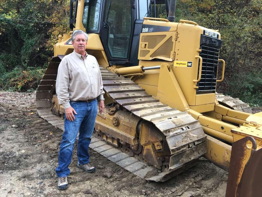 Mark Williams, Summit Development, Radford, Va., considers bidding on this Cat D6N dozer.