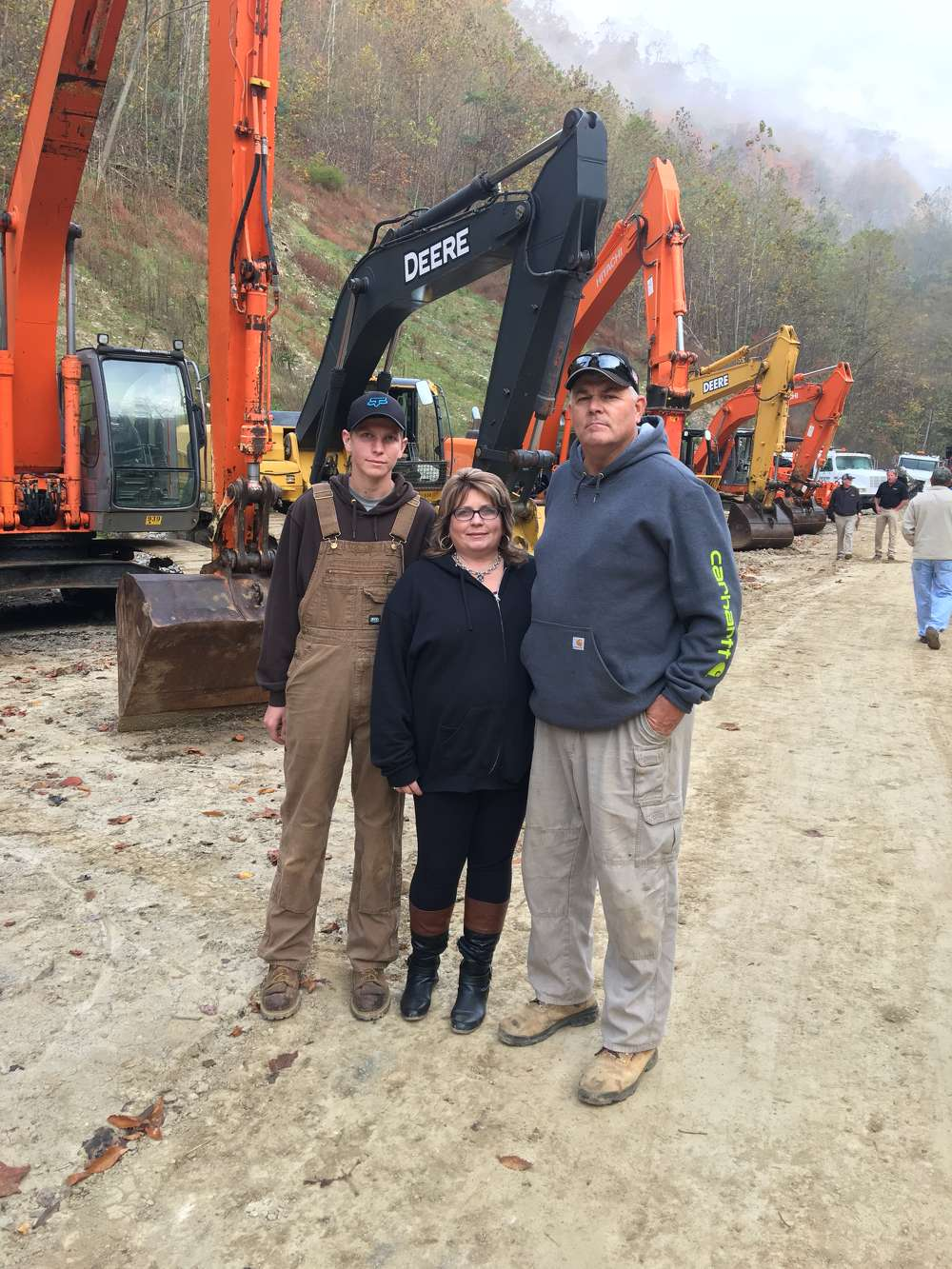 (L-R): Scott, Kim and Charlie Wells, all of Wells Construction in Roanoke, Va., shop the selection of equipment at the auction.