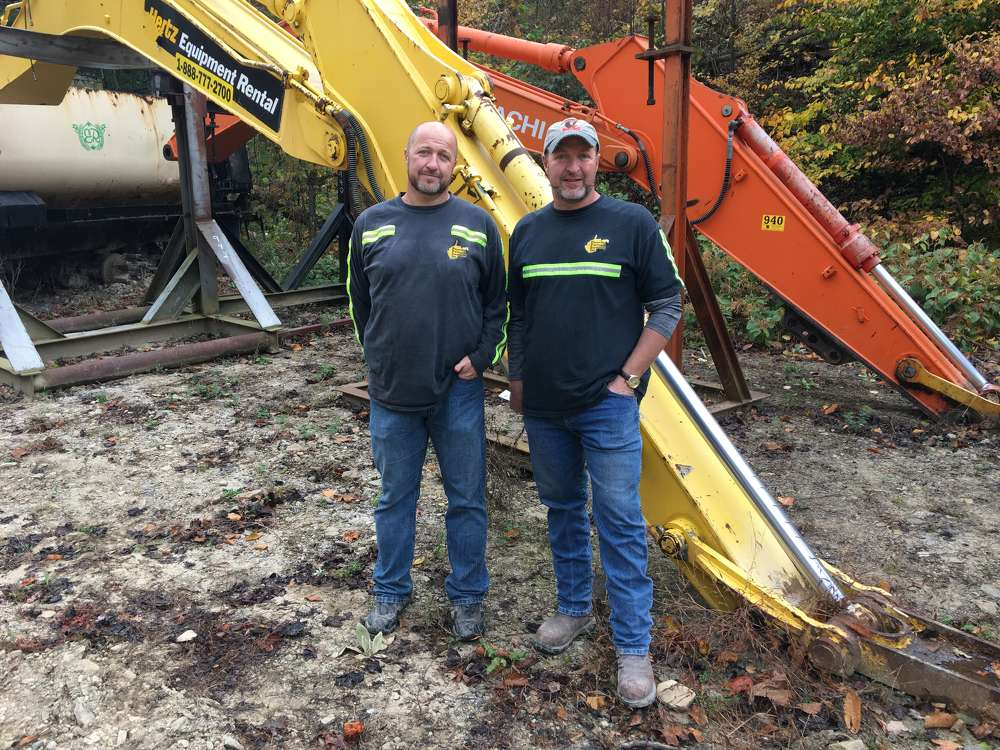 Tony (L) and Kevin Bradford, both of Pineville Paving & Excavating in Pineville, Ky., attend the auction.