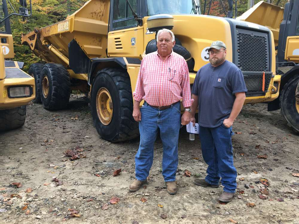 Rick Sowers (L) of Sowers Construction Co. in Mt. Airy, N.C., and Bryan Waddell of B.M. Waddell Equipment in Mt. Airy, inspect the artic trucks.