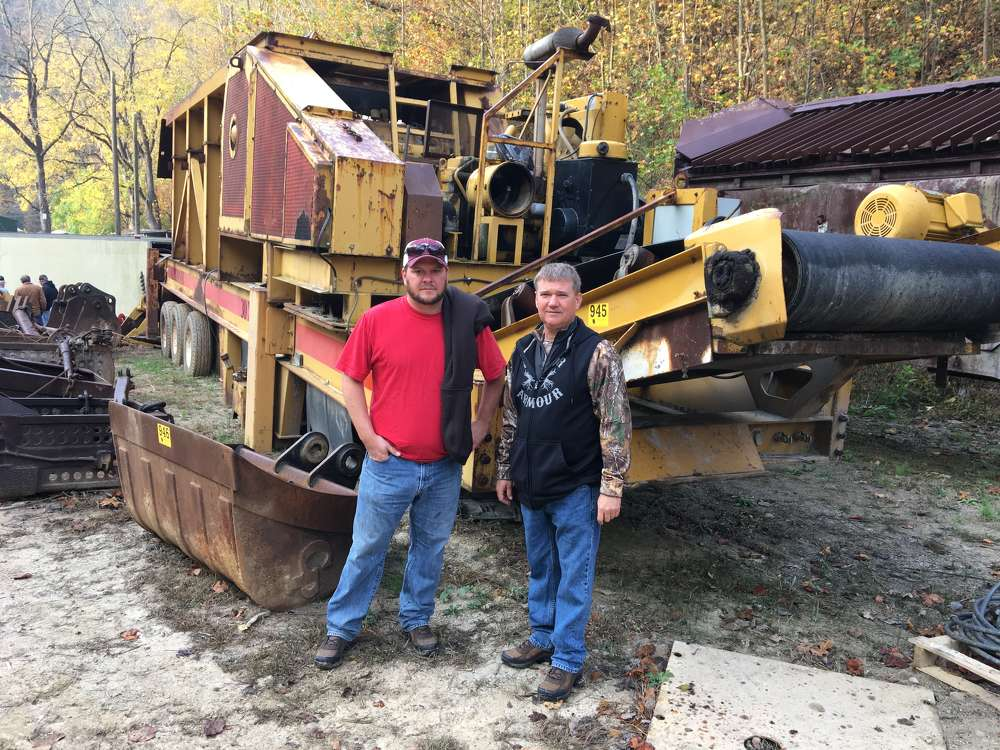 Adam Smith (L) and Bud Kirk, both of Blue Line Stream Restoration in Louisa, Ky., show interest in this CEC 30x42 crusher.