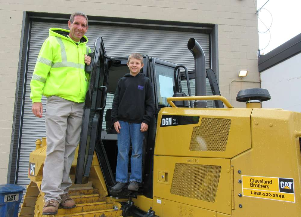 Rob Shuster of RWS Development Co. Inc. brought his son, Rob Shuster Jr., for a closer look at this Caterpillar D6N dozer.