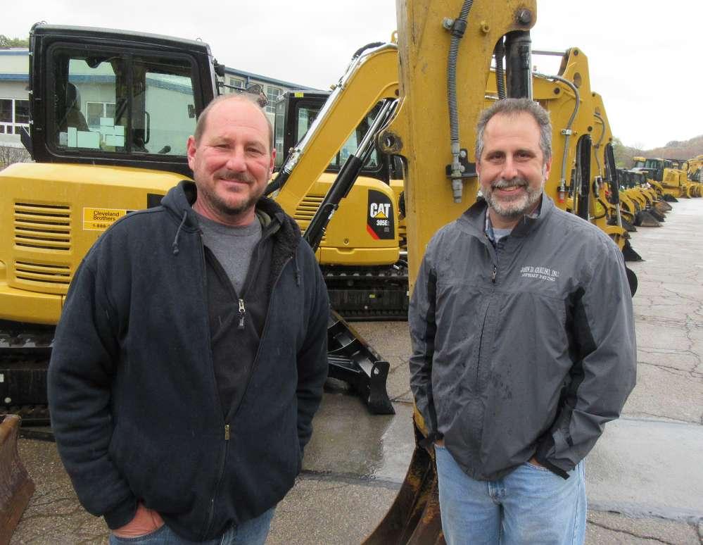 Ken Guerra (L) of Guerra Excavating Inc. and John D. Caruso of John D. Caruso Inc. Asphalt Paving came in search of deals.