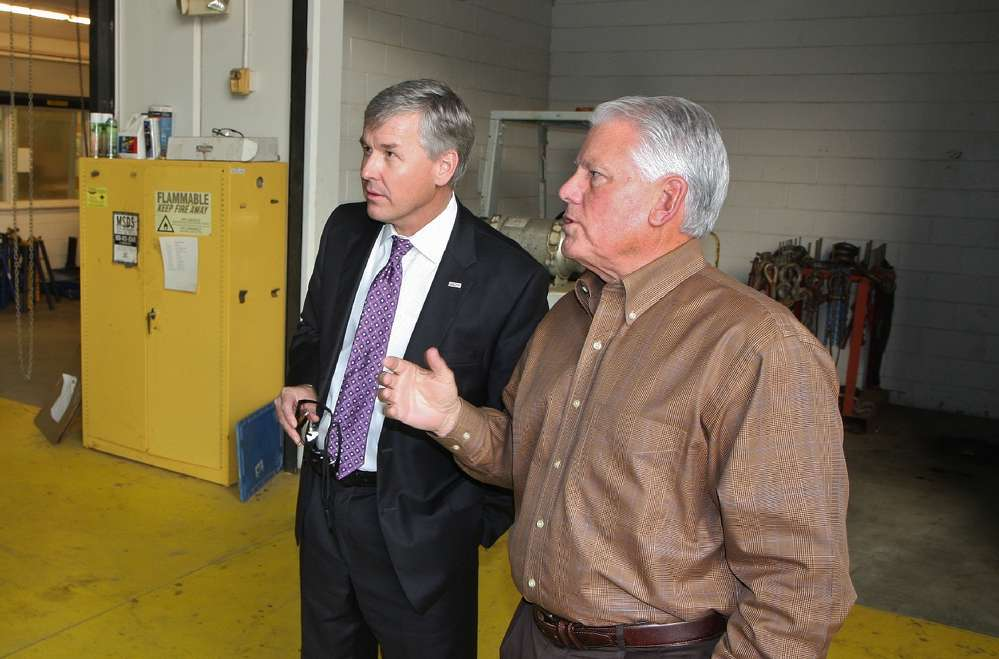Rep. Rob Woodall (L) and Jack Evans, general manager of ASC Georgia, discuss the equipment dealer's operations in Buford, Ga.