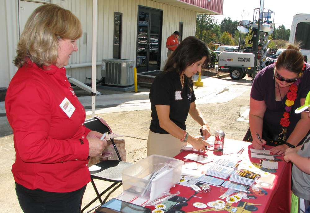 Joy Leake (L) and Laura Starace of Yancey welcome and register guests for a selection of prizes.