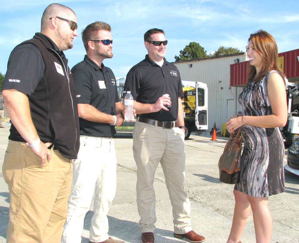 (L-R): Brinson Roland, Quinn Dyas and Jason Christian, Yancey Rents, talk with Amanda Hammons of LakePoint Sporting Community, Emerson, Ga., about the company's project development of an additional 800 acres at the complex and its equipment needs.
