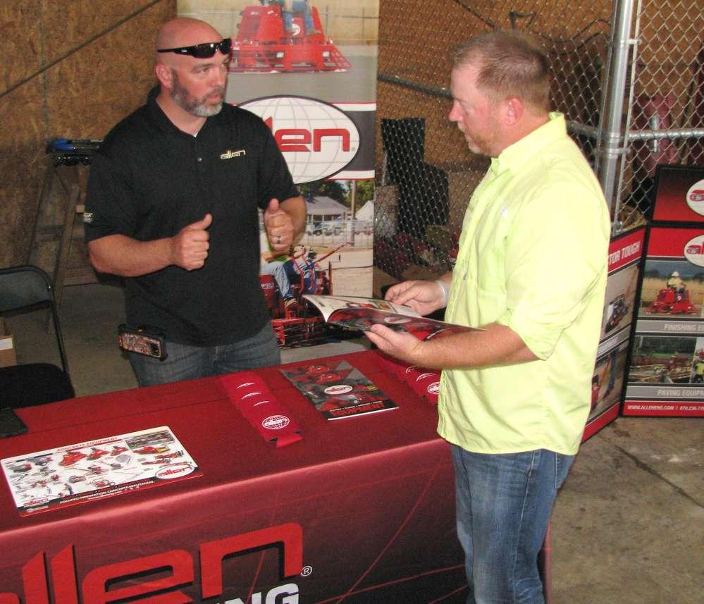 Jimmy Mason (L) of Allen Engineering, Paragould, Ark., and Jason Bridges of Glosson Enterprises, Acworth, Ga., talk about Allen Concrete Equipment products.