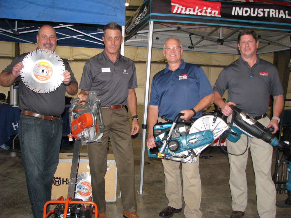 (L-R): Jim Wilson and Randy Silver of Husqvarna  and Russ Pierce and Larry Bruner of Makita, exhibit the company's newest hand tool products.