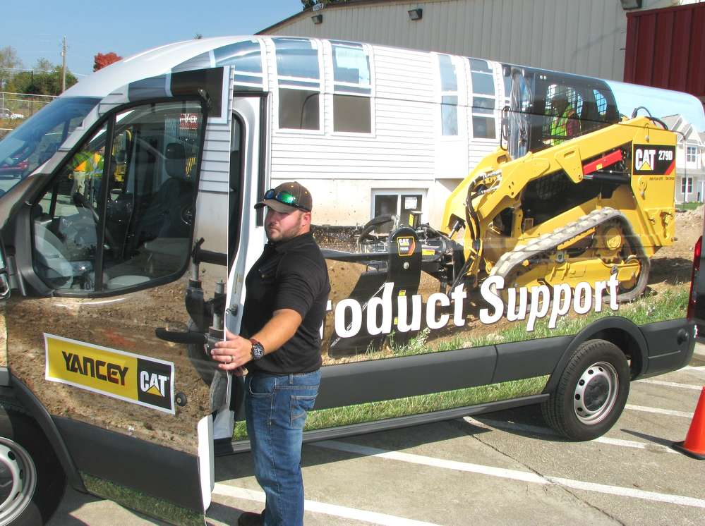 Warren Turner, Yancey Bros. Co. CCE product support specialist, rolls in to the event with one of the company's newest specialty product support vans.
