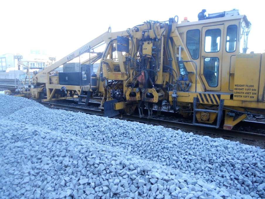 WSDOT photo. A Jackson 6700 tamper lines and tamps new track at King Street Station, where a $38.5 million rail improvement project is under way.