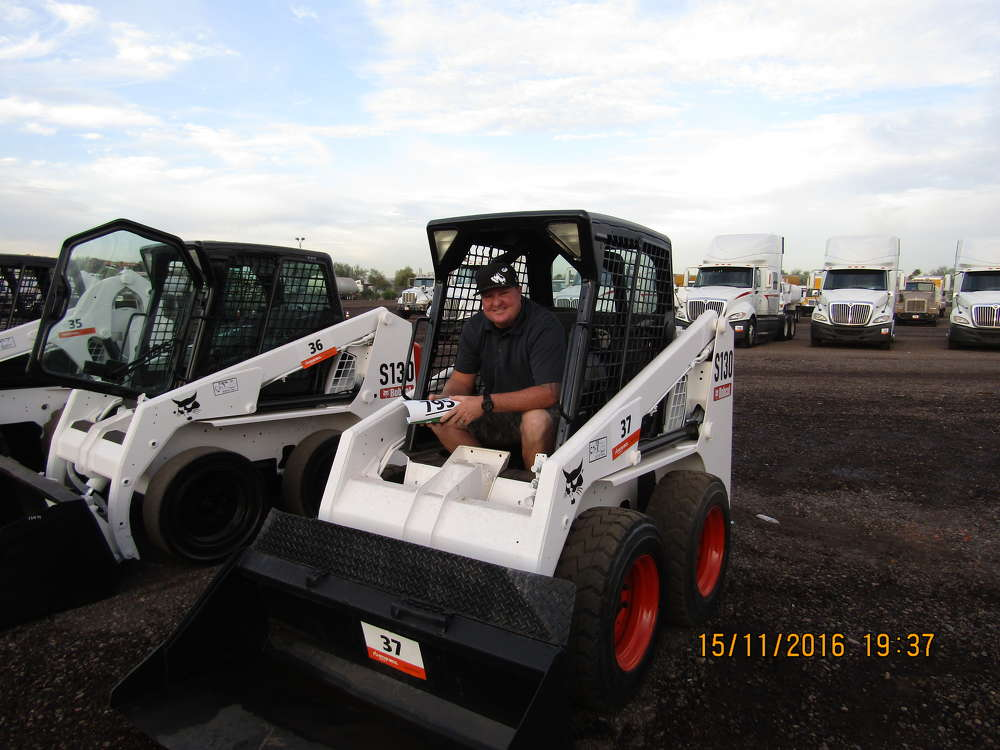 Chris Collinsworth of Pacific Construction in Highland, Calif., tests out this Bobcat 5130 skid steer loader.