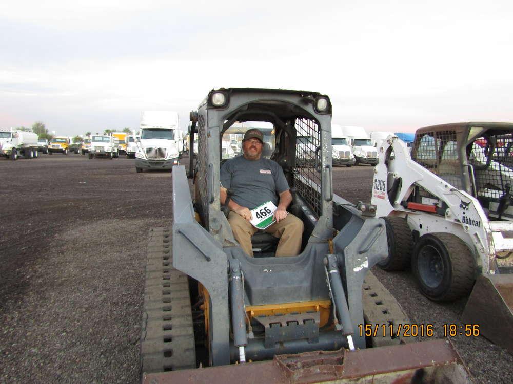 Haskel Reynolds of Mongollon Construction in Heber, Ariz., looks over this John Deere 323D compact track loader.