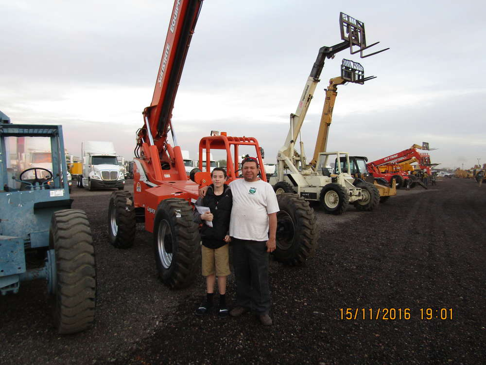 Nivaro Diaz (R) and son, Nick, of Nivaro Construction in Bozeman, Mont., drove all night to be at the auction. They were looking at this JLG 8042 telescopic lift.