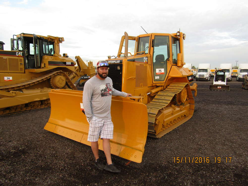 Drew Nelsen of MDG Resources, a gold mine in Arizona, hopes to have the winning bid on this Cat D5N LGP crawler dozer.