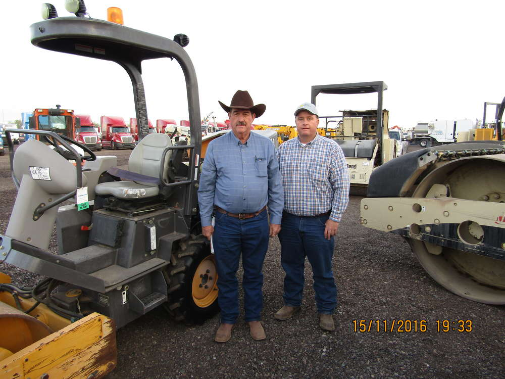 Frank Dalmolin (L) and his son, Frankie, of 5D Mining and Construction in Globe, Ariz., browse the yard.