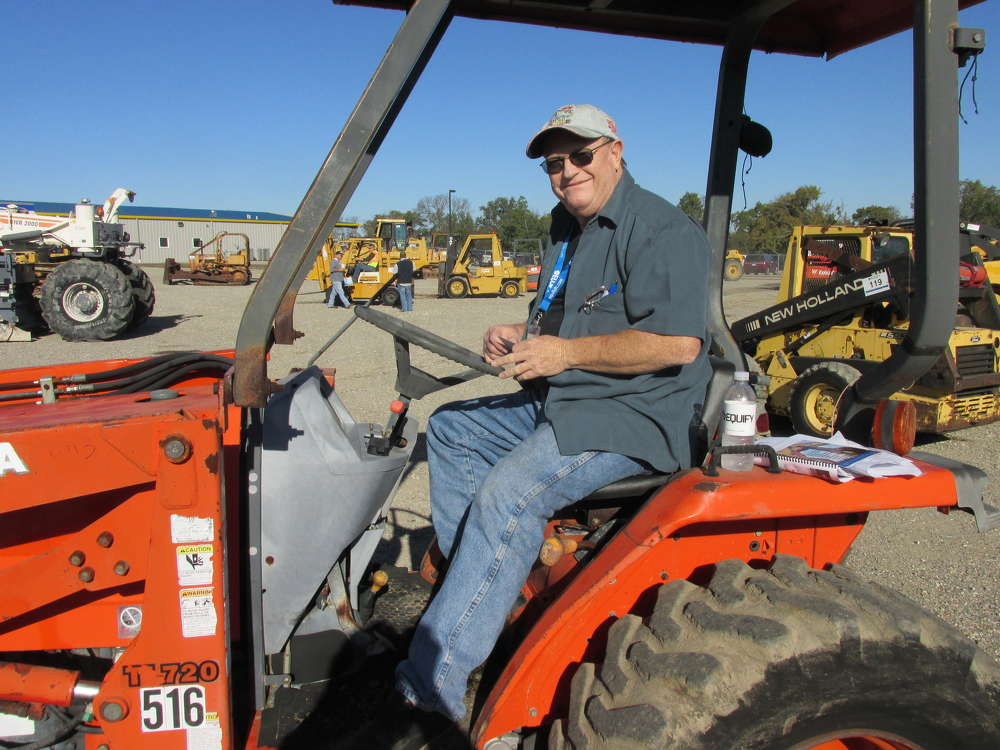 Mayo McClellan, Mayo Tractors in Daingerfield, Texas, tests this Kubota TL720 loader.