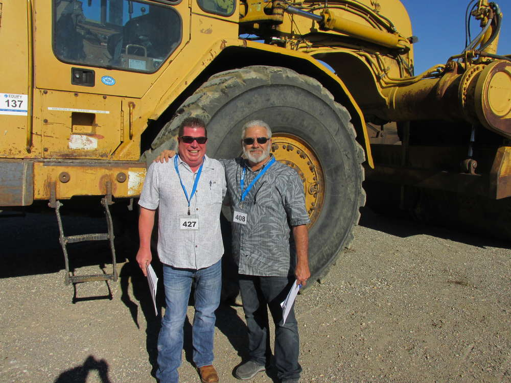 Jeff Miller (L) of Trophy Tractor in Grand Prairie, Texas, and Gregg Hoss of Hoss Machinery International of Irving, Texas, came upon this Cat 637-E scraper.