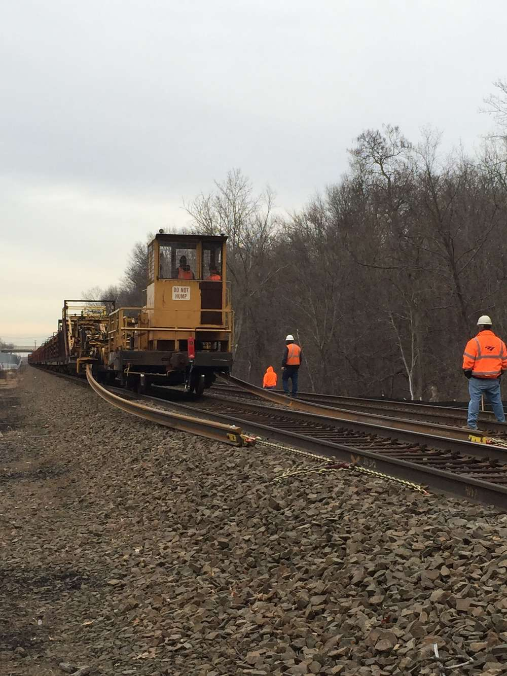 A rail train drops rail for the new line (Connecticut Department of Transportation photo)