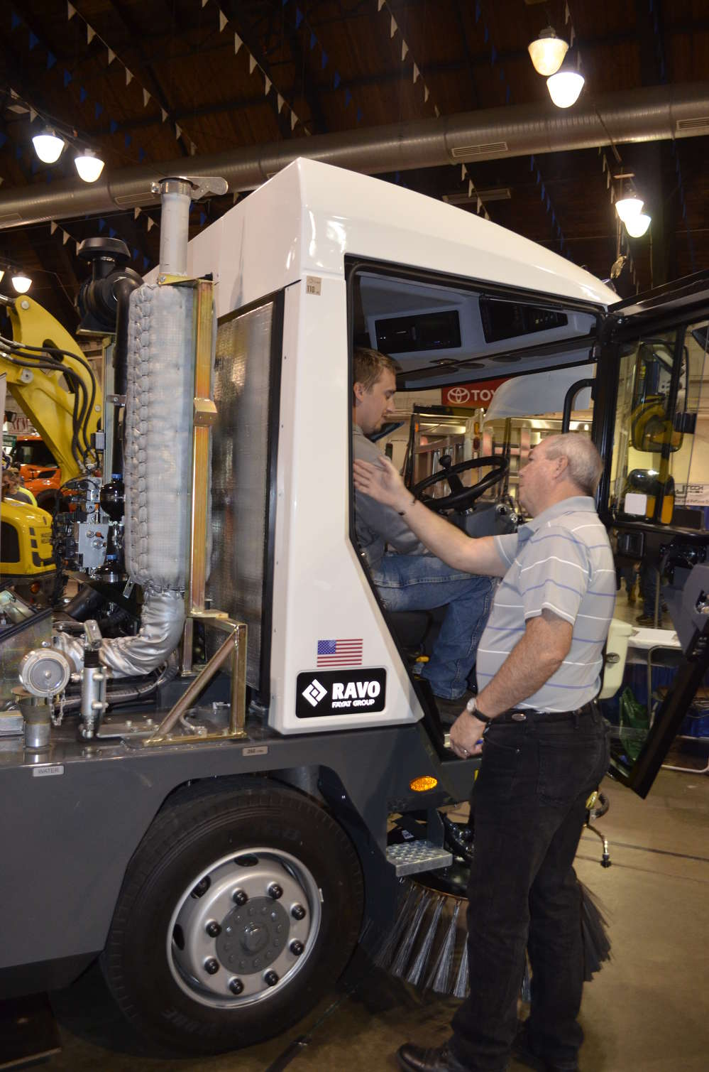 Attendees are able to check out the spacious cab of a RAVO sweeper available from Upstate Sweepers and Rentals.