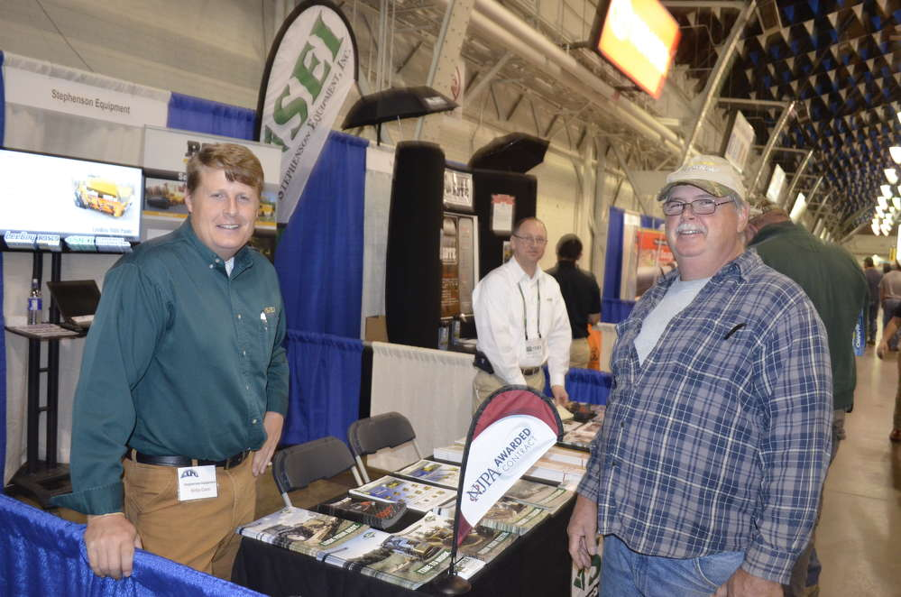 Kirby Coon (L) of Stephenson Equipment discusses the wide assortment of municipal tools available through their stores in Syracuse and Albany, N.Y.