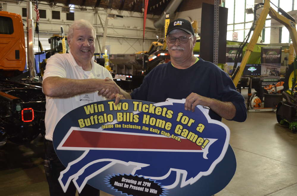 Bob Buckley (L) of Superintendent's Profile congratulates Mike Freeman, highway superintendent of the town of Philadelphia, on winning the grand prize of two tickets in the Jim Kelly Club to an upcoming Buffalo Bills home game.