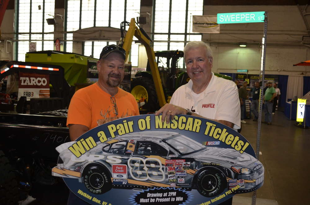 Jeff Card (L) of the village of Corning highway department is congratulated by Bob Buckley of Superintendents Profile for winning a pair of tickets, including pit passes, to the 2017 NASCAR race at Watkins Glen.