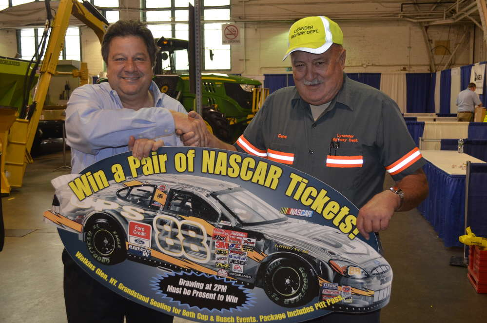 Kent Hogeboom (L) of Superintendent's Profile congratulates Gene Dinsmore, highway superintendent of the town of Lysander, on winning a pair of tickets, including pit passes to the 2017 NASCAR race at Watkins Glen.