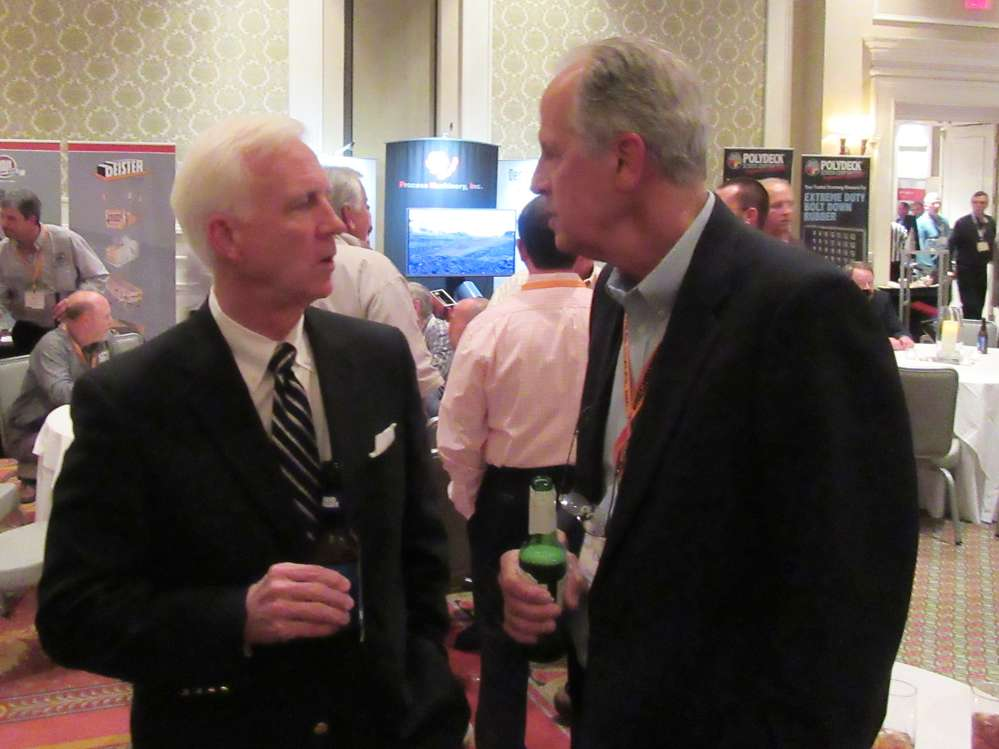 Clay Graham (L) of Shelly & Sands catches up with Charlie Patterson, Southeastern Equipment Company.