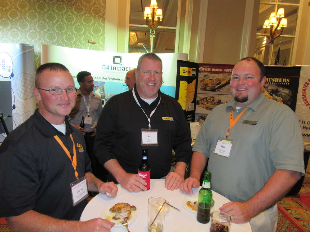 (L-R): Aaron Mittendorf, Jeff Dress and Mike Cullen, all of Ohio CAT, enjoy the OAIMA reception.