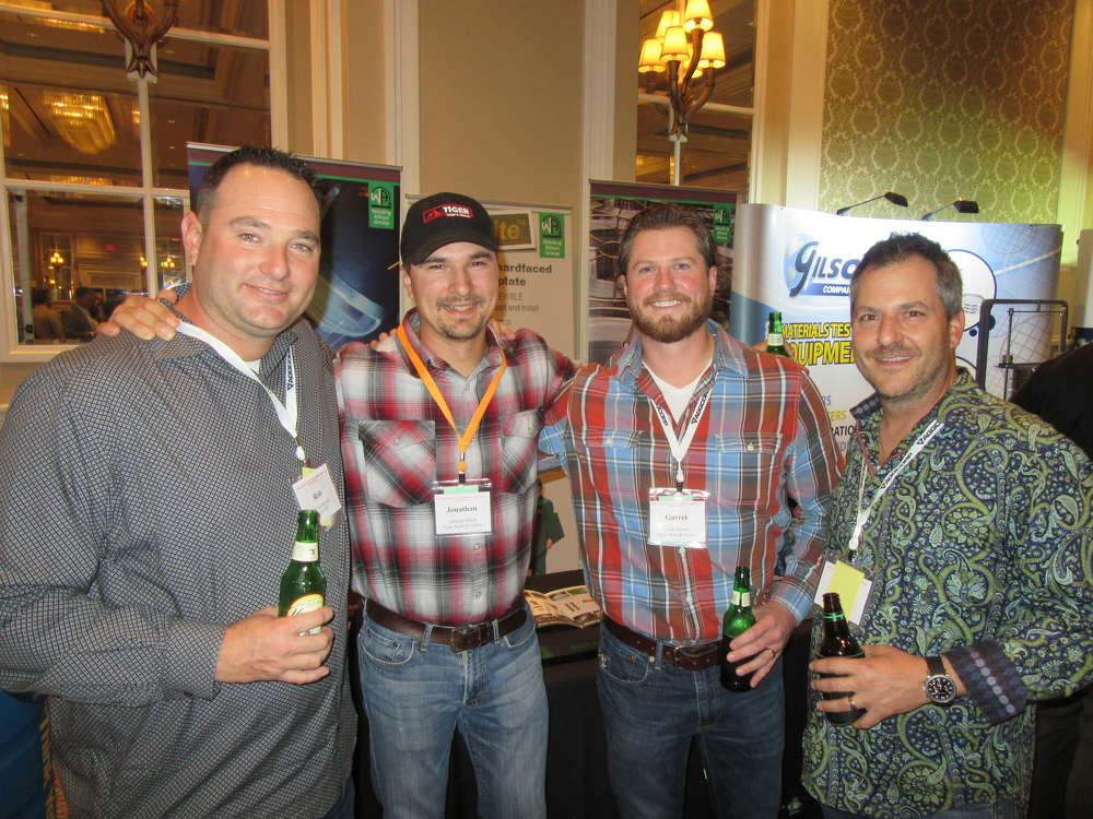 (L-R): Roberto Armbruster, Aggcorp, talks with Jonathan Stock and Garret Kloots, both of Tiger Sand & Gravel, and Chris Toiga, also of Aggcorp.