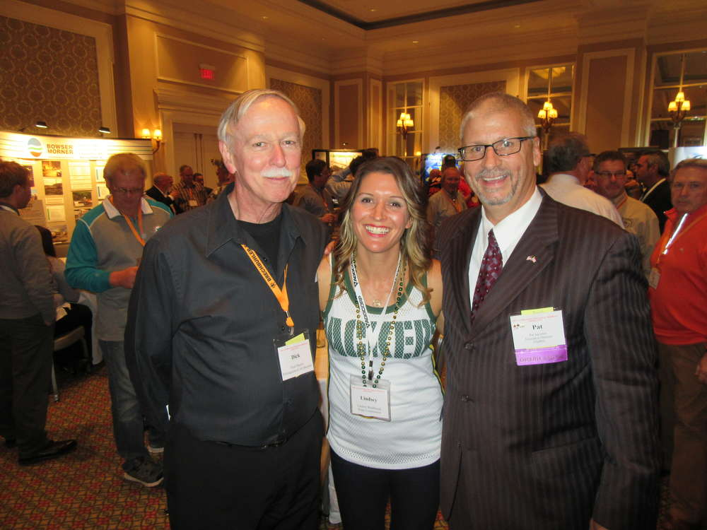 (L-R): Dick Martin, OAIMA distinguished lifetime member, and Lindsey Radabaugh of Rupp Construction share a laugh with Patrick Jacomet, OAIMA executive director.