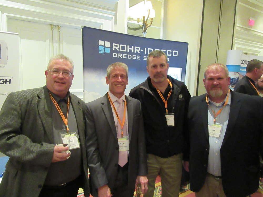 (L-R): Tony Ruggiero of Mar-Zane Materials speaks with Martin McCutcheon, Rudd Equipment Company; Mike Cline of Shelly & Sands; and Josh Poston of Rudd Equipment Co.
