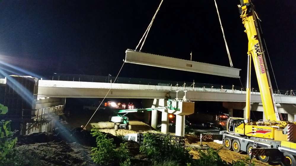 Crews lift beams into place at the site of a new four-lane Interstate 95 overpass on Fall Hill Avenue in the city of Fredericksburg.