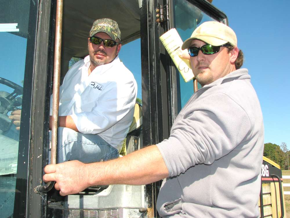 Tim Haley (L) of H&H Equipment, Haleyville, Ala., and  Jeremy Gibbs of Gibbs Farm & Timber, Brilliant, Ala., test out this Cat IT28G.