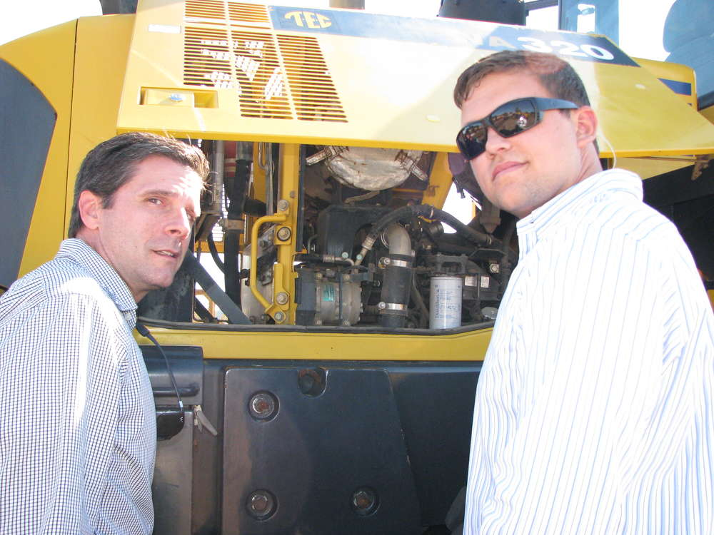 Craig Pyles (L) and Jacob Pyles, both of Pyles Concrete, Columbia, Ky., inspect the engine of this Komatsu WA320 wheel loader.