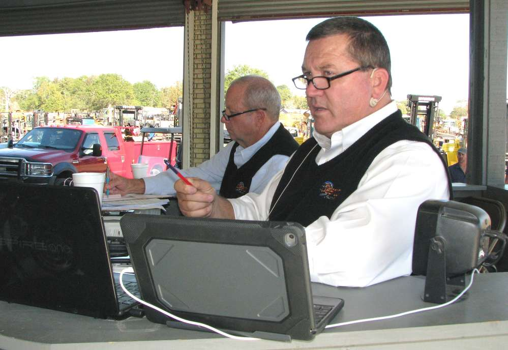 Pendy Ellard (L) and Donnie Dean keep things running smoothly at the sale.