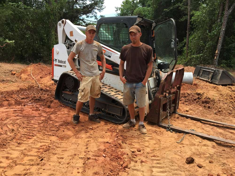 Calvin Coponen (L) and Dean Goddard have both been very happy with the company's eight Bobcat machines.