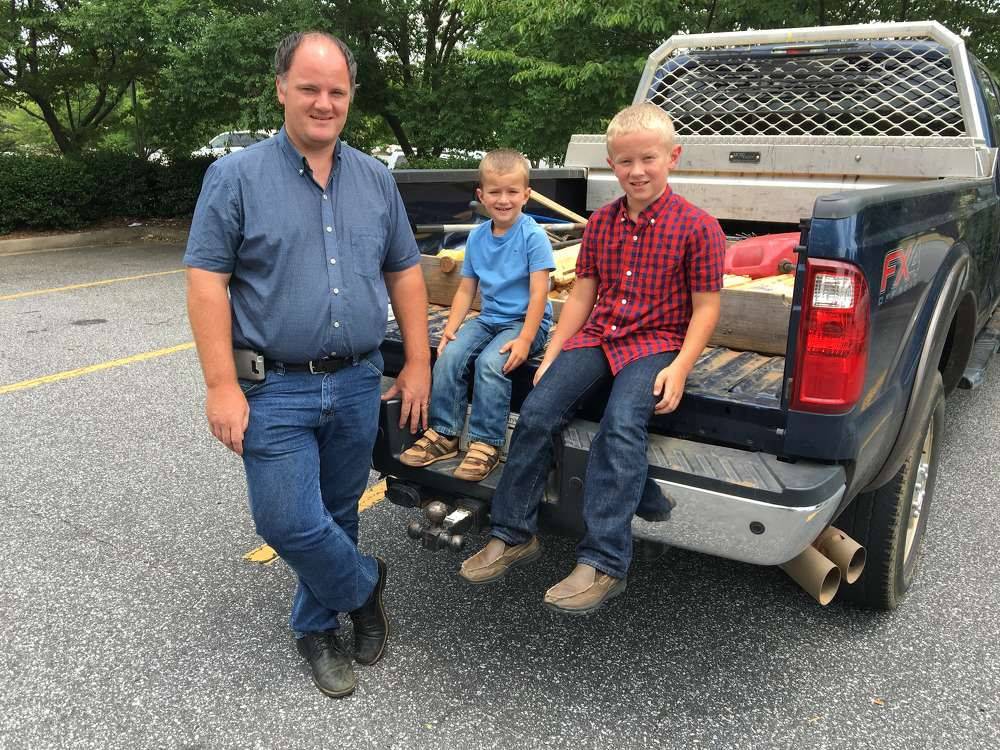 Ryan Kaiser, owner of Enchanted Construction, with two of his sons, Randall and Dean.