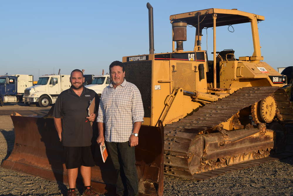 Nathan (L) and Paul Rechichar, Platinum Builders, New Smyrna Beach, Fla., shop the selection at the auction.