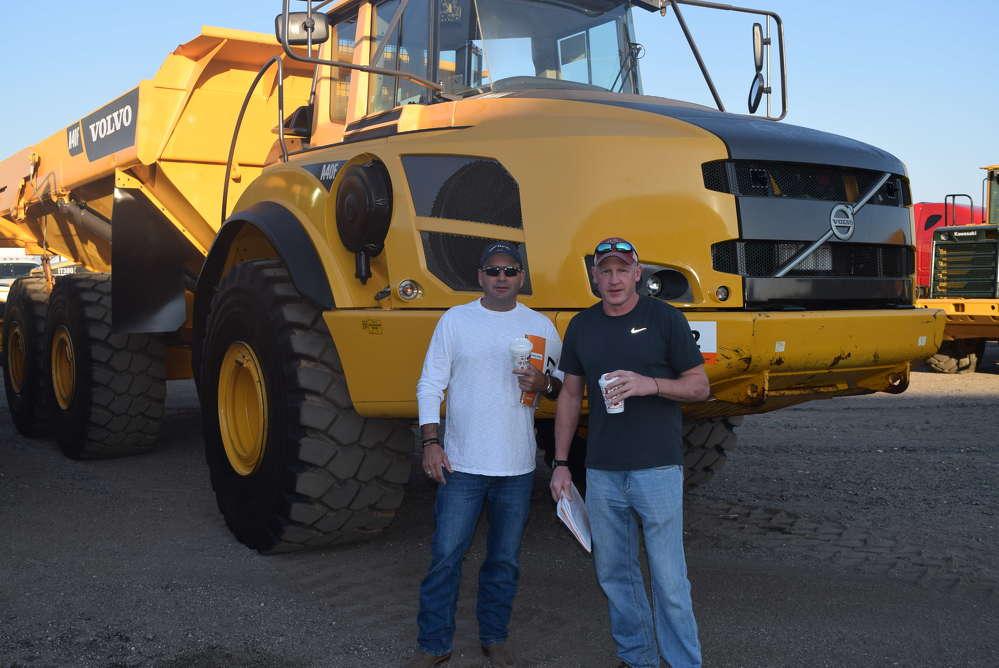 Dan Burke (L), EC&I, and Richard Wojtkowski,  Pittsfield Lawn & Tractor, Pittsfield, Mass., attend the auction.