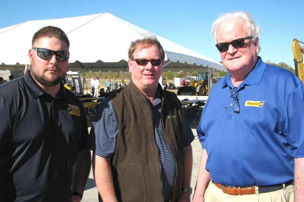 (L-R): Jesse Stanley, Thompson Machinery CAT Rental Store; Andy Atkins, APAC-Northeast Mississippi; and Jim Simmons, Thompson Machinery, talk about the paving projects in the Mississippi market.