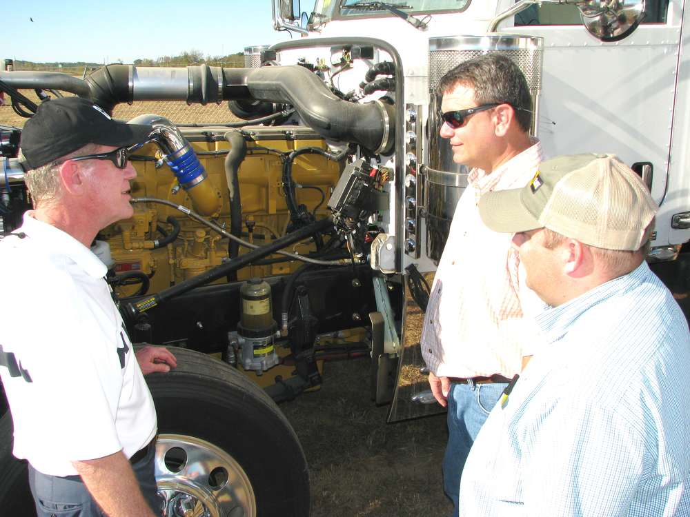 (L-R): Jim Kerschbaum of Thompson Truck Centers, Memphis, Tenn., and Mike Davis and Michael McCarthy, both of Conditioned Air, Tupelo, Miss., check out the over-the-road truck products on display.