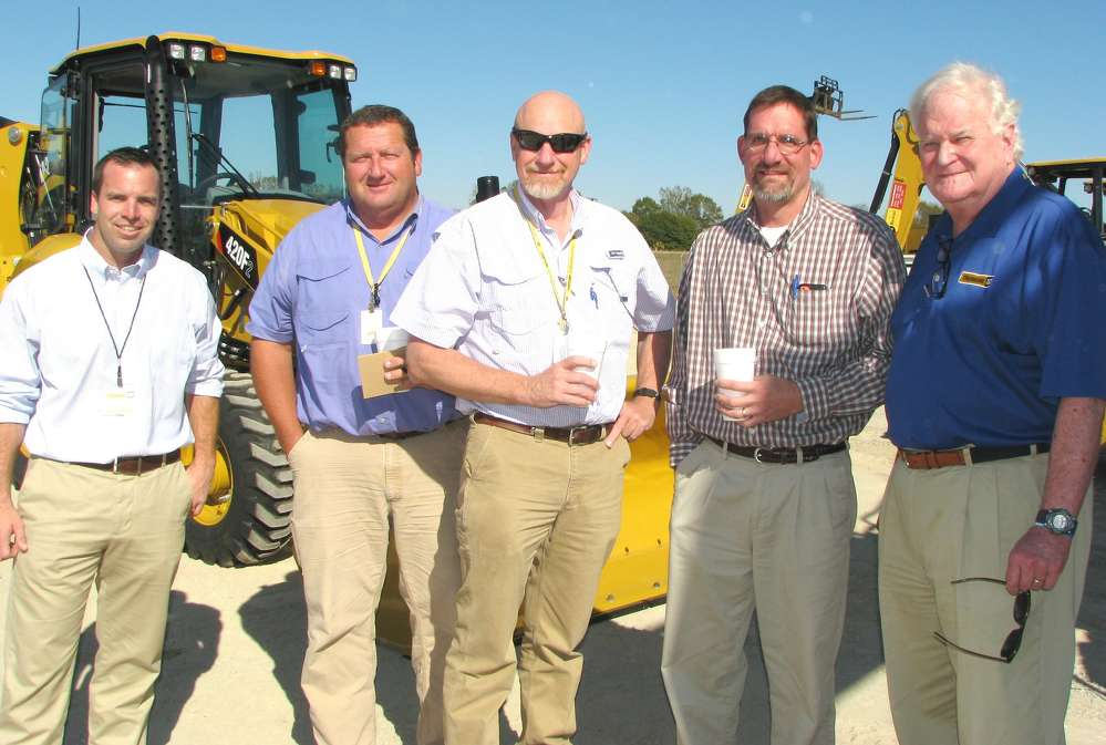 (L-R) are Tom Simmonds, Thompson Machinery; Doug Horton, David Horton and John Evers, all of Century Construction, Tupelo, Miss.; and Jim Simmons, Thompson Machinery.