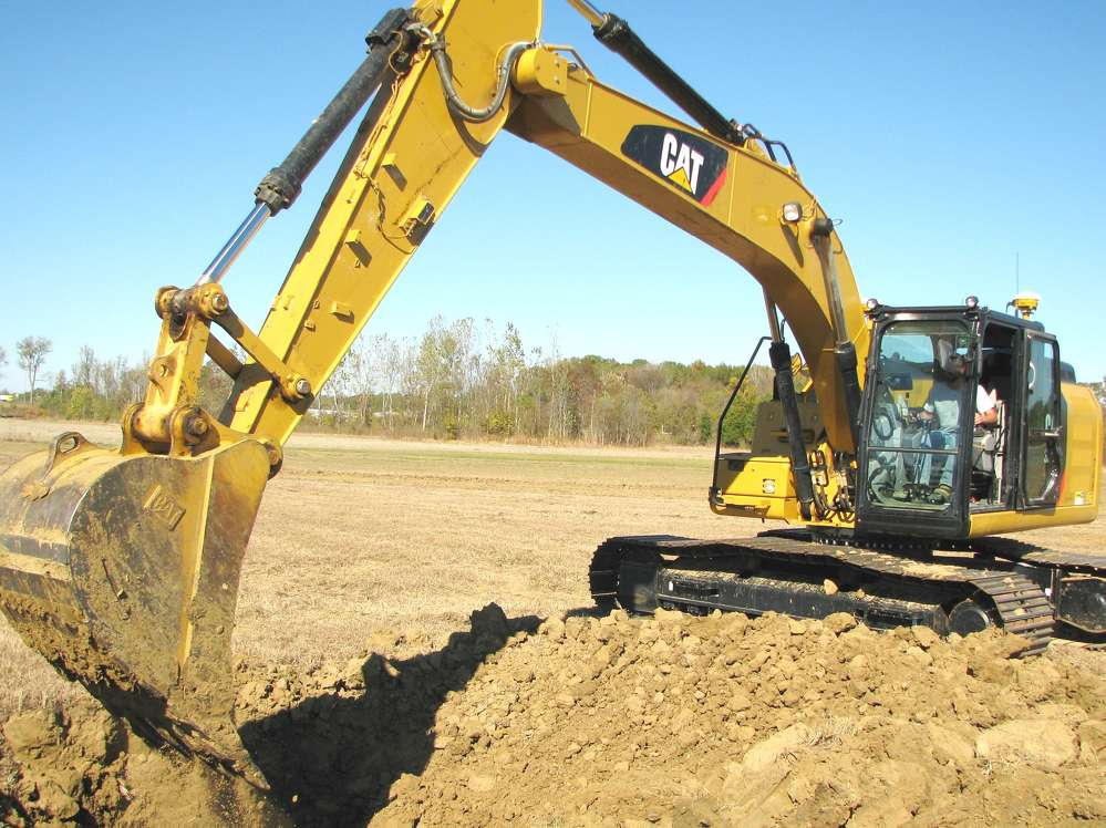 Guests enjoy the opportunity to operate the Cat 323F L with factory installed, fully integrated Cat grade control system.