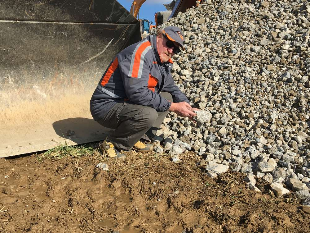 Perry Holt of Rockster goes through the crushed concrete pile.