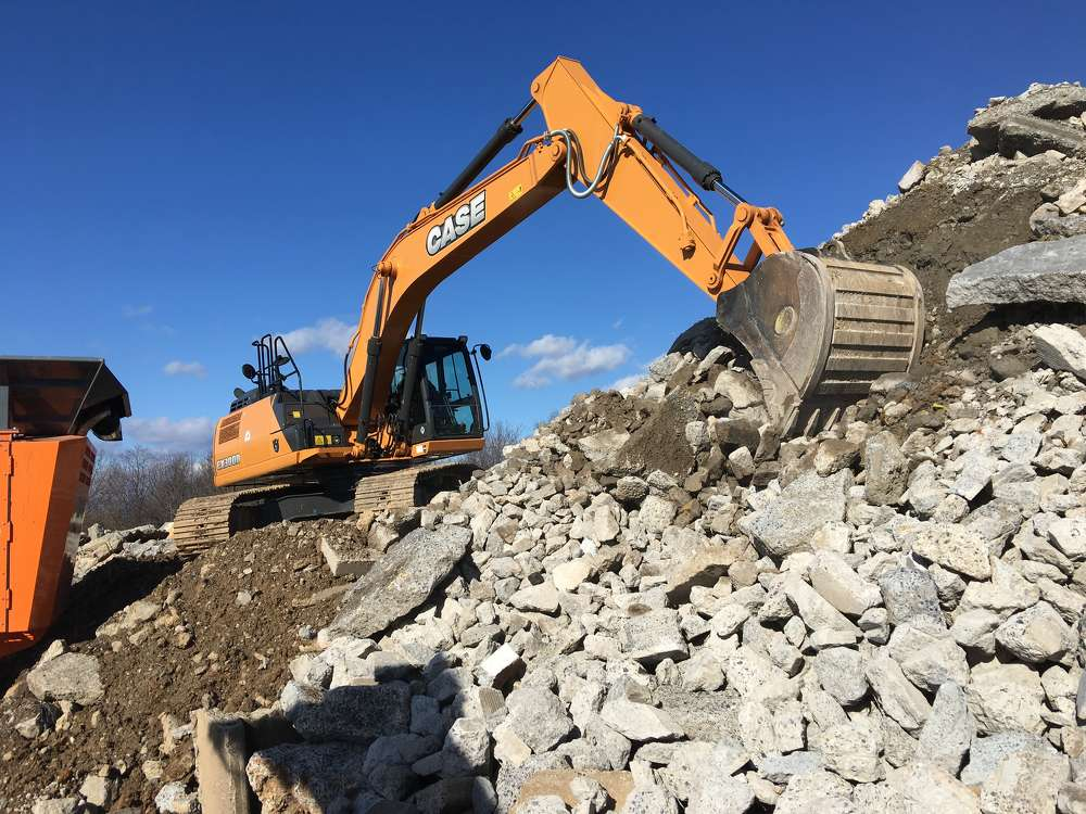 The Rockster impact crusher reduced the concrete and granite to the set size.